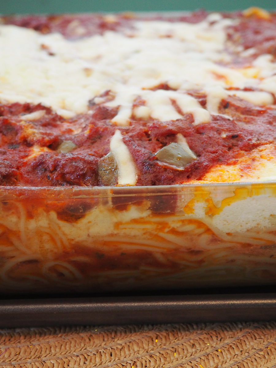 Try this delicious spaghetti bake recipe! It is easy to make, rich, and sure to become a family favorite.